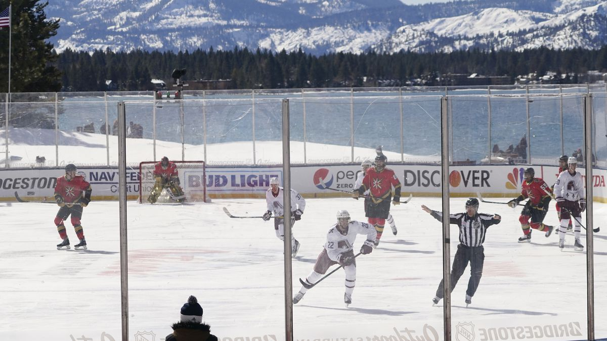 Members of the Colorado Avalanche, in white, and the Vegas Golden Knights, red play during the...
