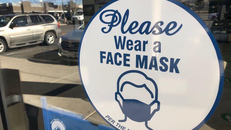 Sign requiring a mask.