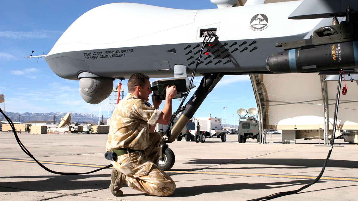 Royal Air Force Cpl. John Watt, 42nd Attack Squadron avionics specialist, prepares the MQ-9 Reaper for launch at Creech Air Force Base. U.S. Air Force Photo by Lawrence Crespo