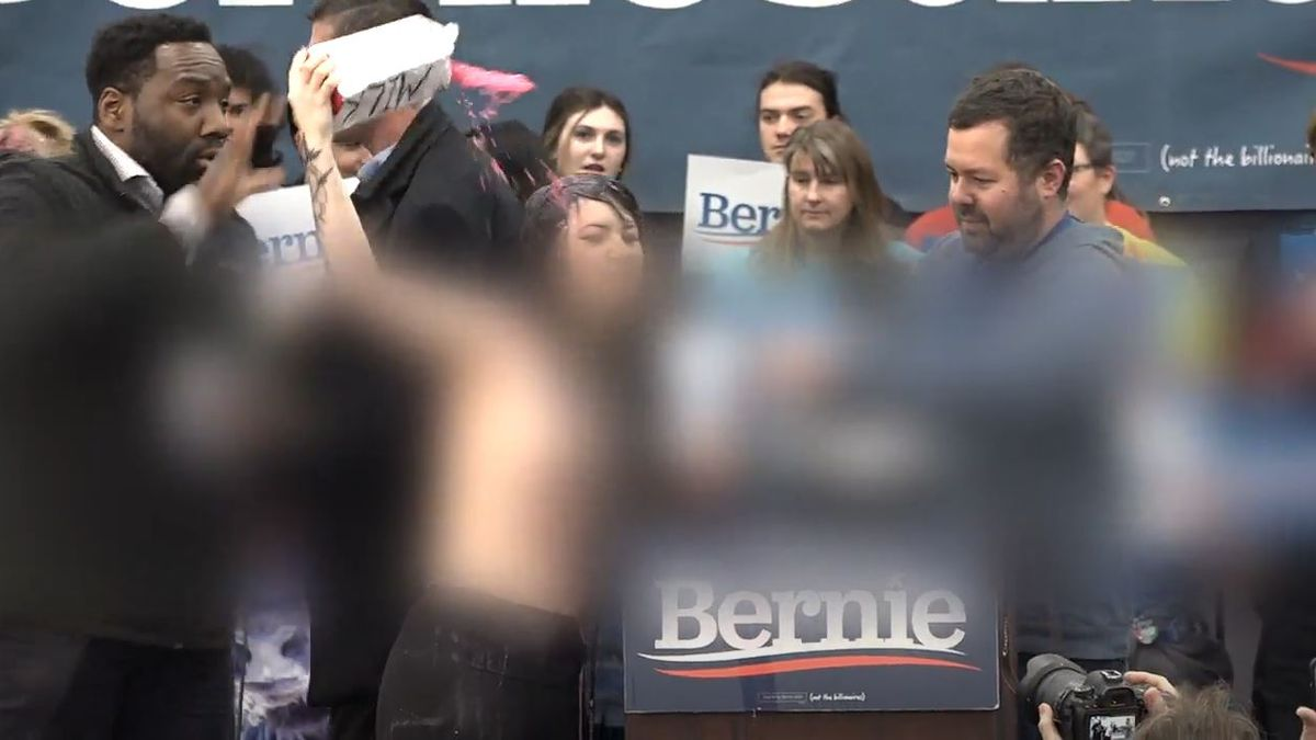 Topless protesters at the Bernie Sanders campaign in Carson City. Photo by Abel Garcia/KOLO.