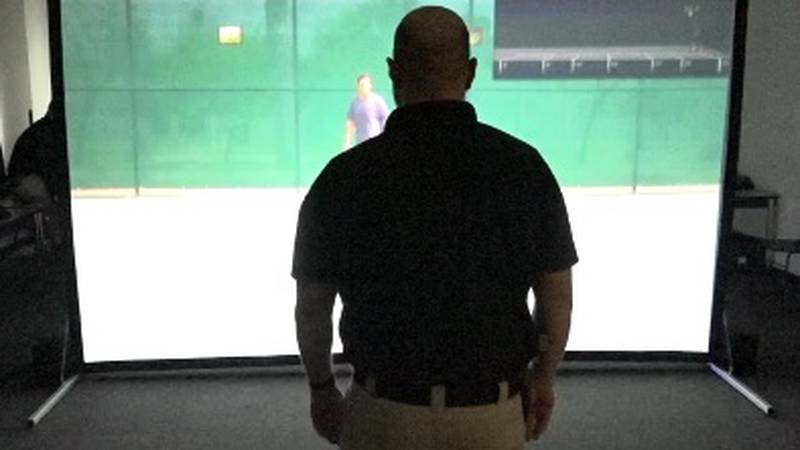 A Sparks Police Officer uses the Virtra Simulator to practice proper use of force and...