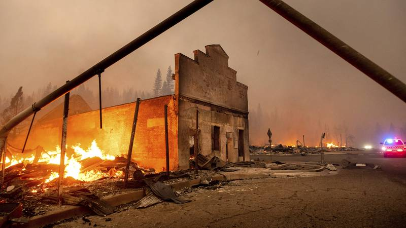 The Way Station bar burns as the Dixie Fire tears through the Greenville community of Plumas...