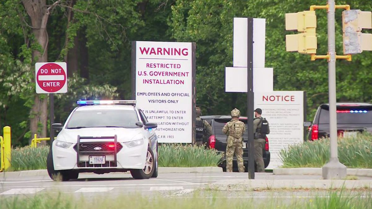 At least one FBI agent opened fire on an armed man outside CIA headquarters in Virginia.