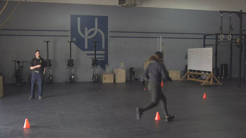 A Reno Police Department recruit runs through one of the drills at the Upstate Nevada CrossFit...