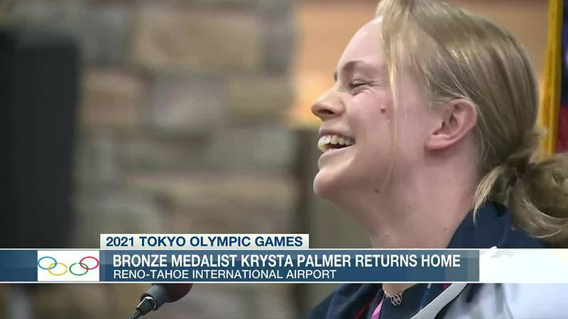 Olympic medalist Krysta Palmer talks with her fans Tuesday, August 3 upon returning to the...