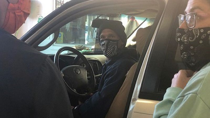Navy Veteran Dominic Eldridge sits in car given to him by CoAuto