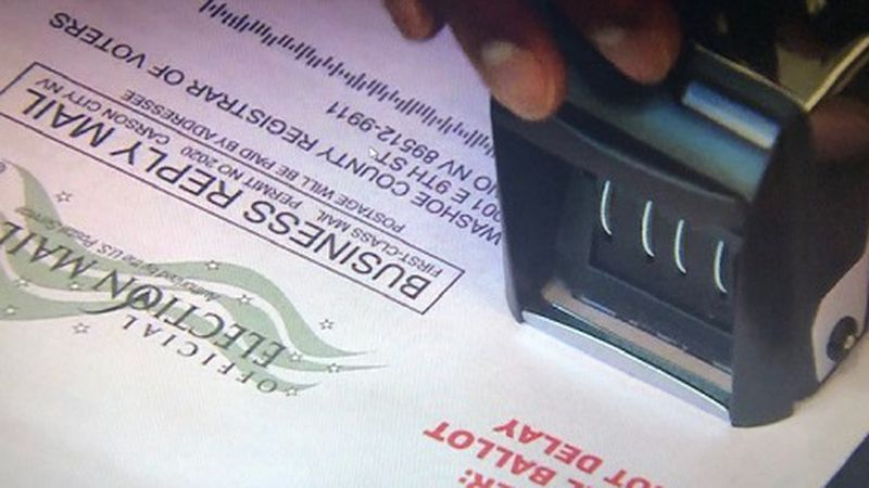 Hand in ballot being marked by Washoe County Registrar's Office