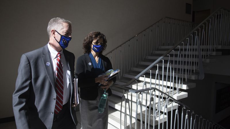 State Senators Keith Pickard and Heidi Seevers Gansert walk together on Wednesday, Aug. 5,...