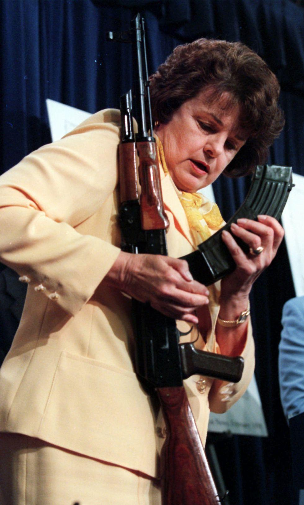 In this March 31, 1998, file photo, Sen. Dianne Feinstein, D-Calif., examines a magazine clip...
