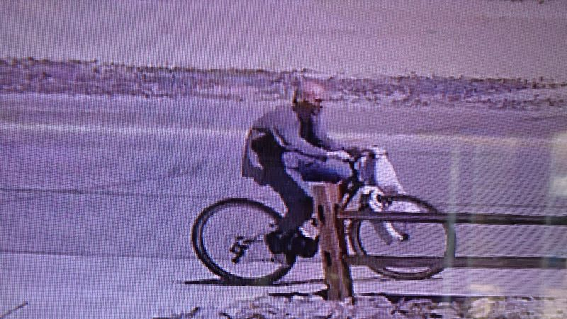 The alleged suspect in a home burglary on Mark Way is seen riding a stolen bicycle.
