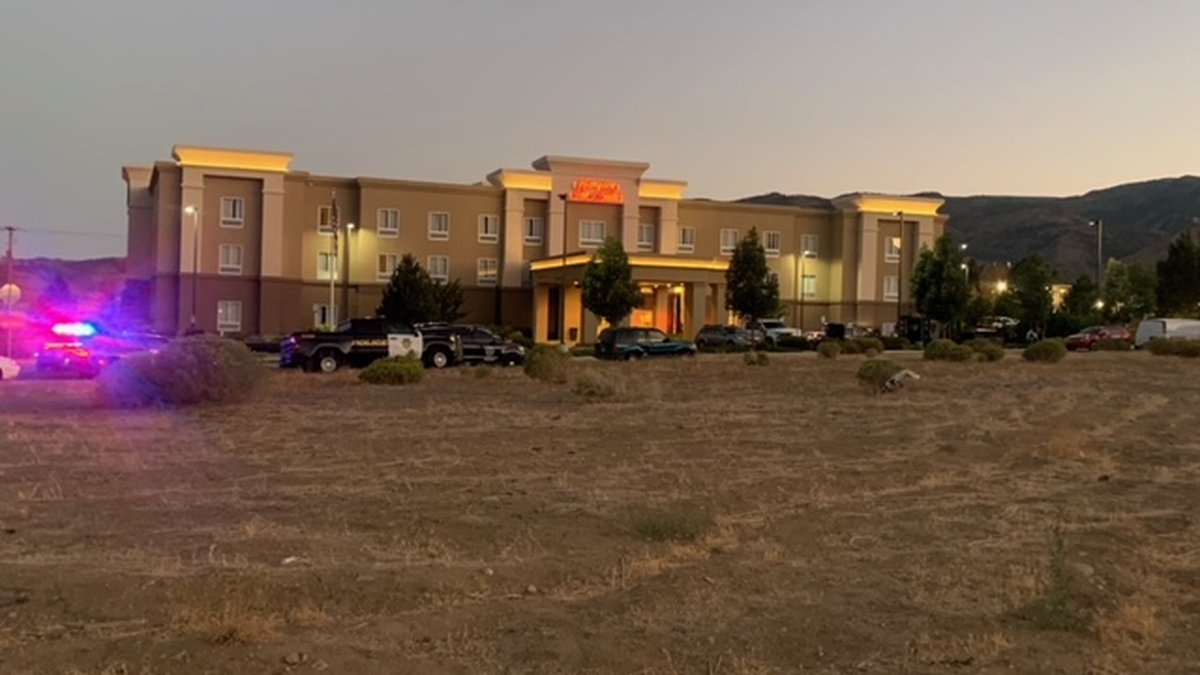 Police deal with a standoff outside the Hampton Inn in northwest Reno.