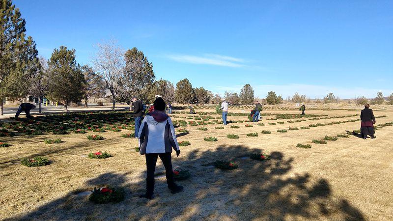 Volunteers lay wreaths at the Northern NV Veterans Memorial Cemetery