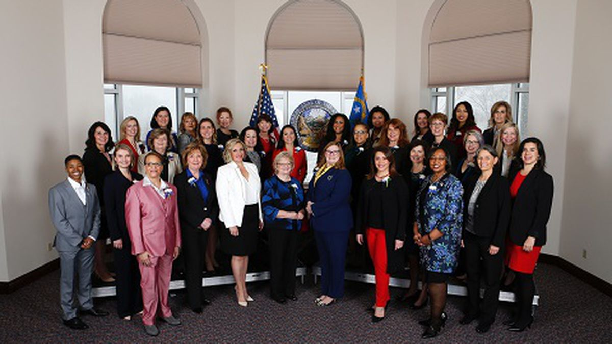 Thirty-two female members of the Nevada Legislature pose for photos before the start of the...