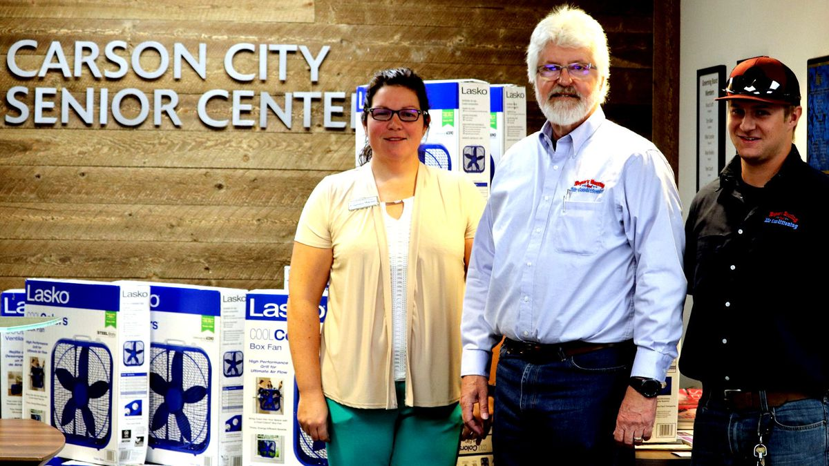 Carson City Senior Center Director Courtneey Warner and Dirk Roper of Roper's Heating and Air...