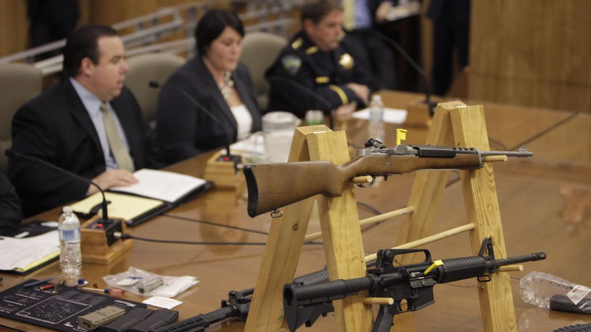 In this Jan. 29, 2013, file photo, semi-automatic rifles and large capacity magazines are...