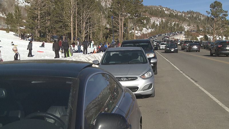 Sledders occasionally fly off the edge of the hill and into the middle of Mount Rose Highway