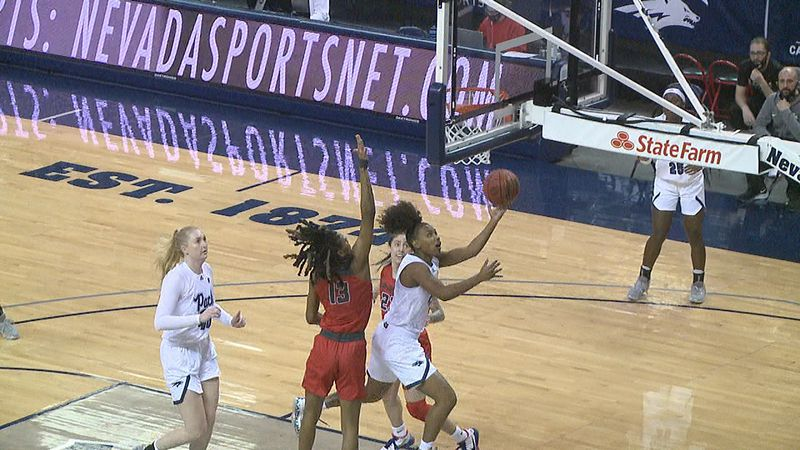 Wolf Pack junior Da'Ja Hamilton tries to convert a layup against the Lobos on Thursday