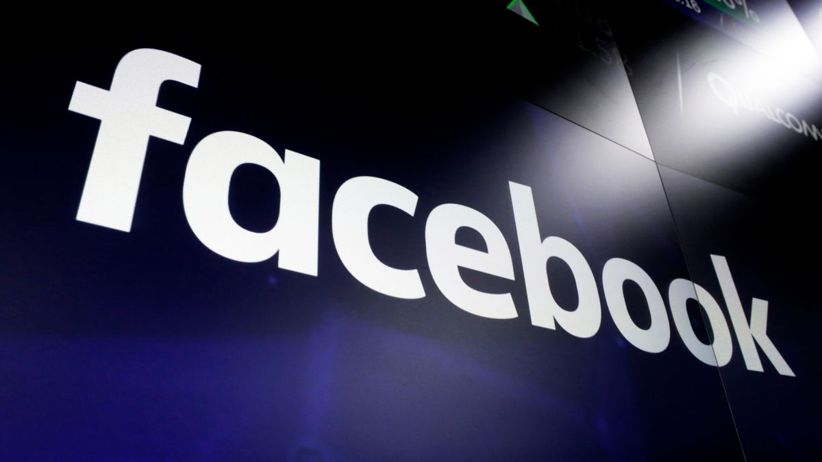 FILE - This March 29, 2018, file photo shows the Facebook logo on screens at the Nasdaq...