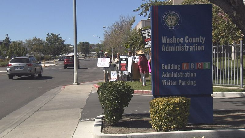 A handful of protesters gathered at the Washoe County Health District.