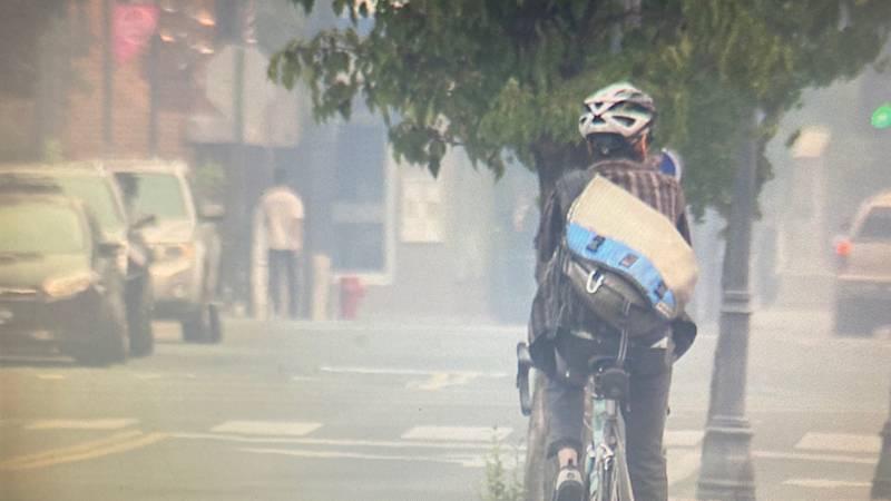 A rare sight: bicyclist on Reno's smoky streets 8/23/21.