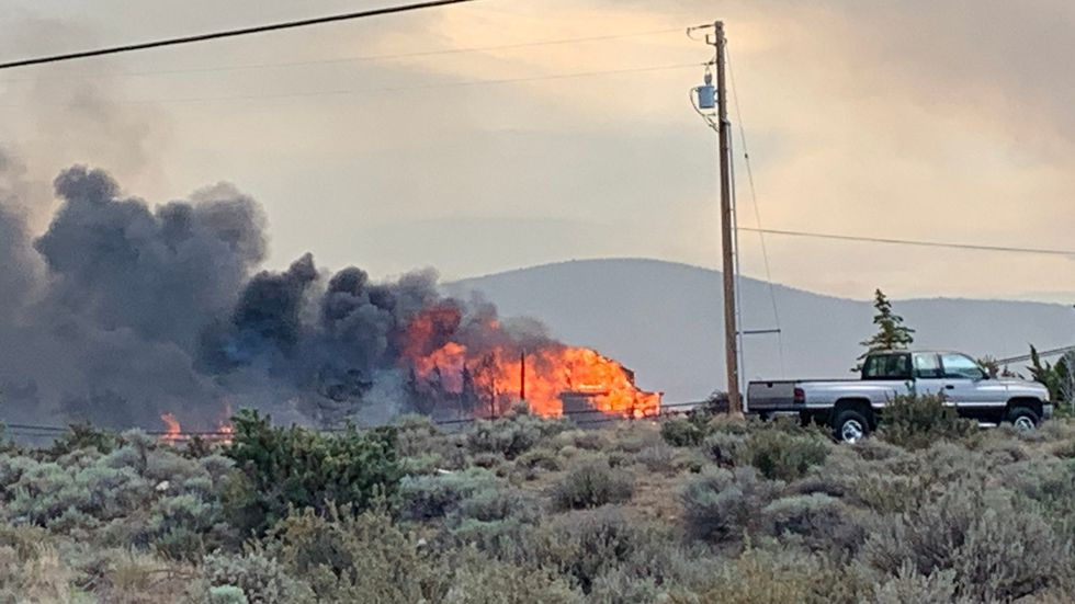 Structures burn as the Poeville Fire sweeps down off Peavine Mountain. The structures burned at...
