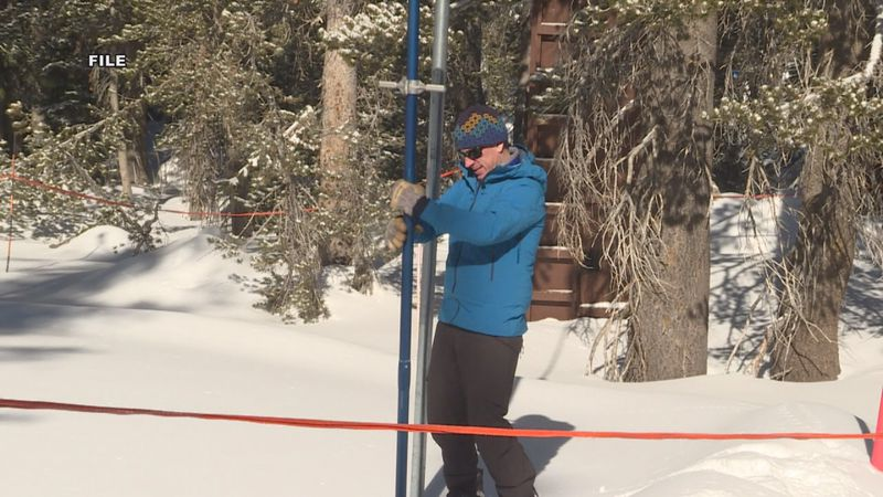 In this file photo, hydrologist Jeff Anderson measures snow levels on Mount Rose.