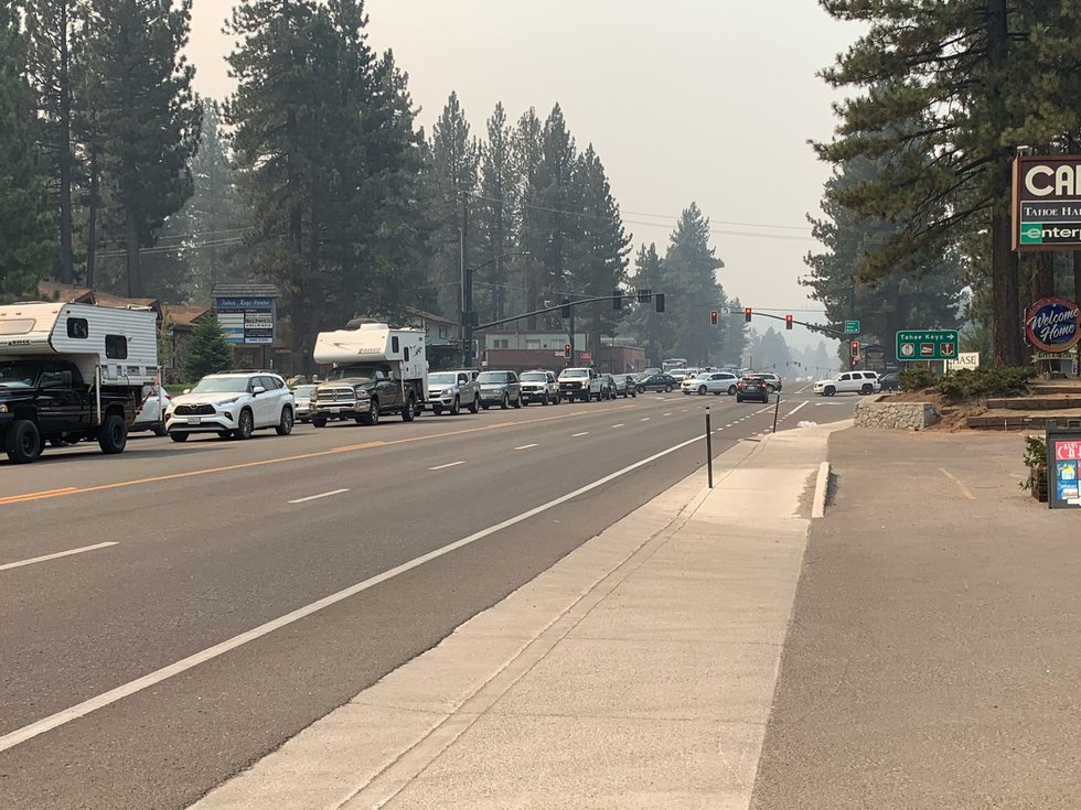 People attempt to leave South Lake Tahoe along Highway 50 as the Caldor Fire prompts new...