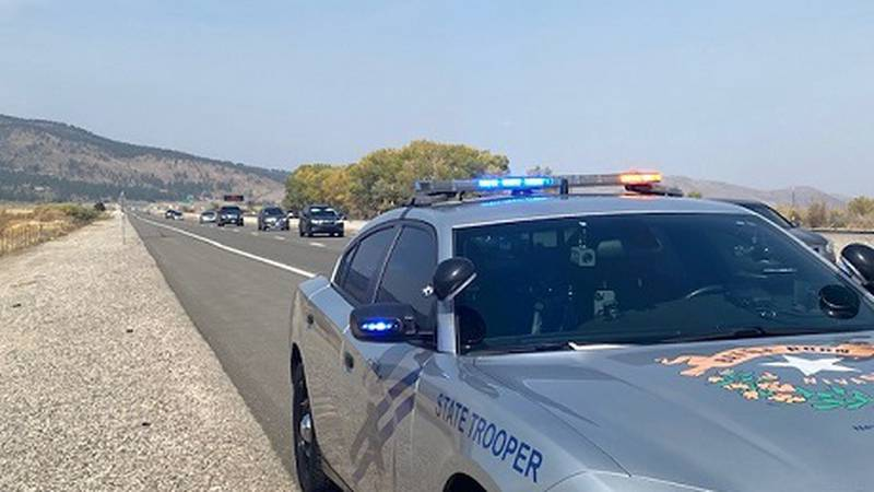 NHP vehicle with emergency lights pulled to side of the road.