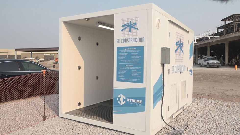 The Xtreme Opti-Clean Cube is a walk-thru structure designed to deactivate bacteria and viruses like COVID-19.