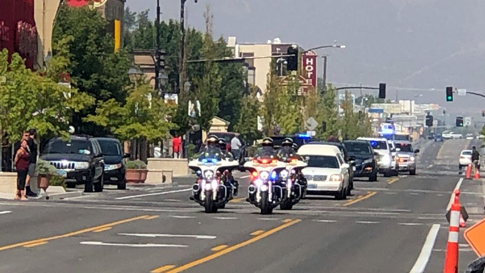 A motorcade carrying the late Carson City Mayor Bob Crowell arrives in Carson City.