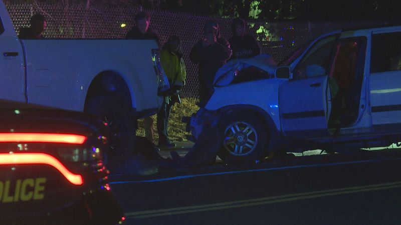 Police investigate after a car crashed into a parked pickup truck near the national auto museum.