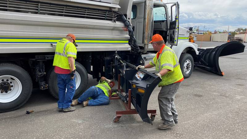 NDOT crew installing a side blade on a snow plow