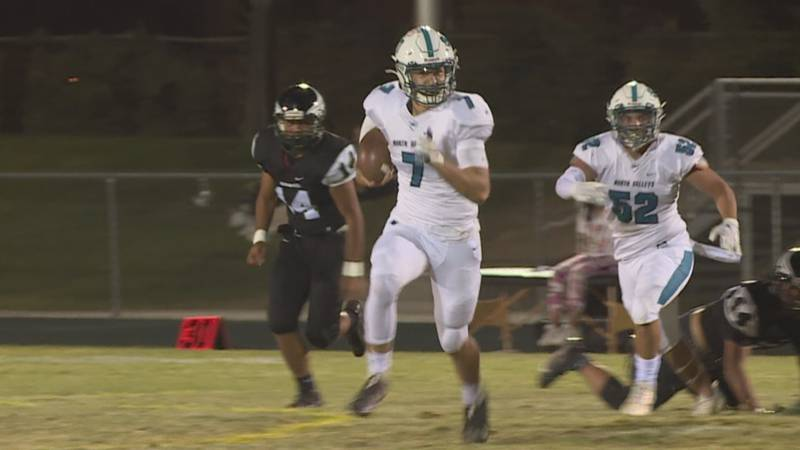 North Valleys' Cam Zeidler runs past the Hug defense in the Panthers Valley Cup win over the...