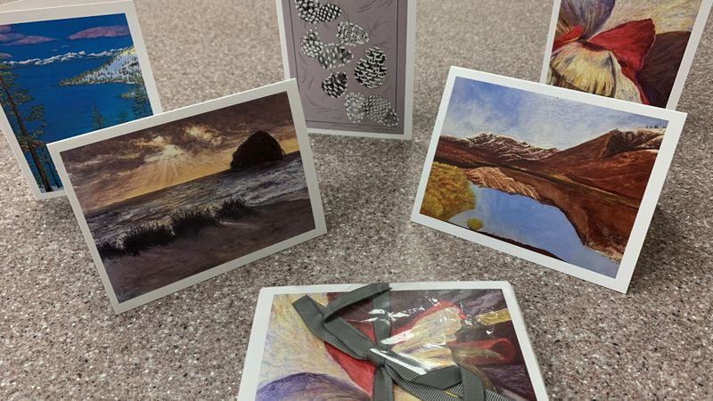 Custom cards featuring artwork created by Western Nevada College students.