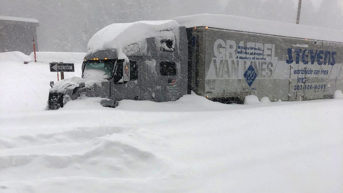 In this photo provided by Caltrans District 9, a tractor trailer that is stuck in heavy...
