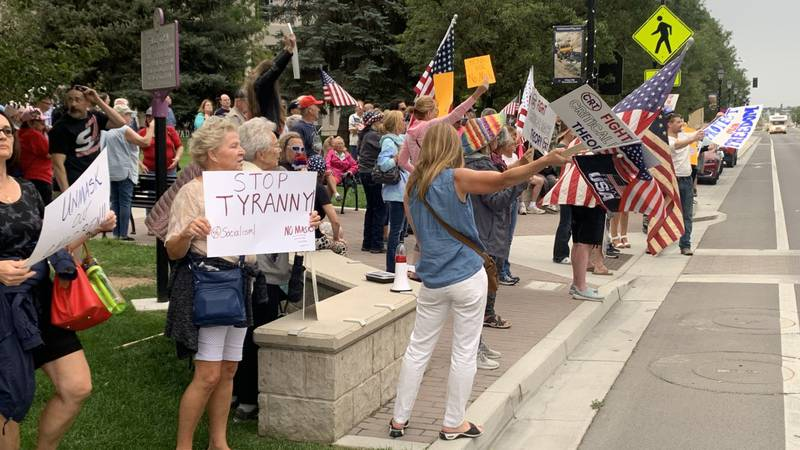 People gather in Carson City to protest against the new mask mandate that goes into effect on...