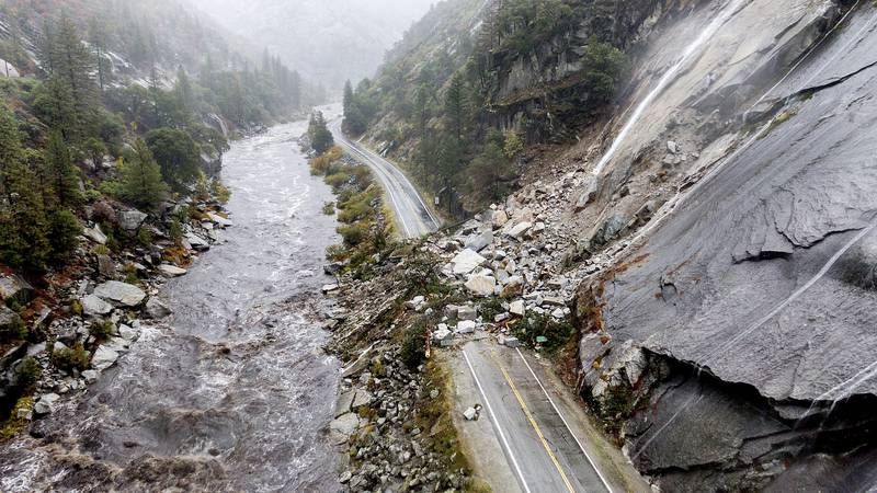 Rocks and vegetation cover Highway 70 following a landslide in the Dixie Fire zone on Sunday,...