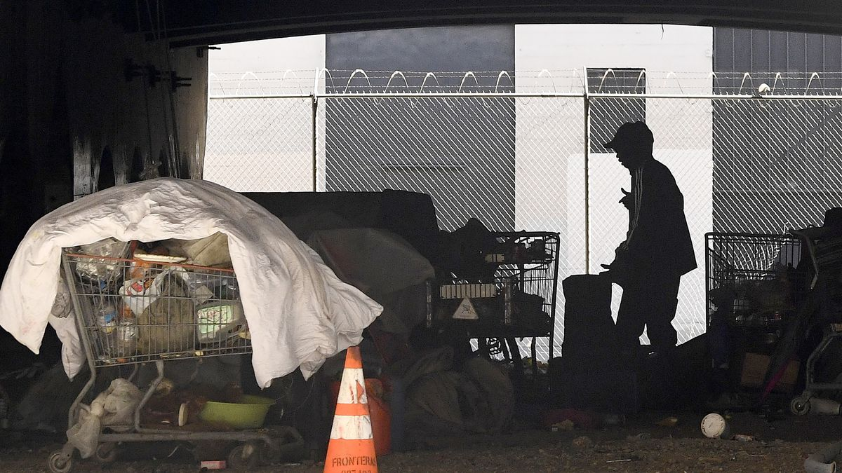 In this May 21, 2020, file photo, a man is seen at a homeless encampment that sits under...