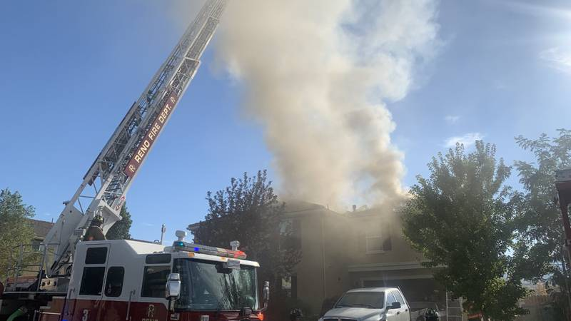 The Reno Fire Department works to put out a house fire on Rivolli Ct. in south Reno.