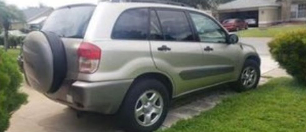 Tan Toyota RAV 4 with California plates: 6NWD443