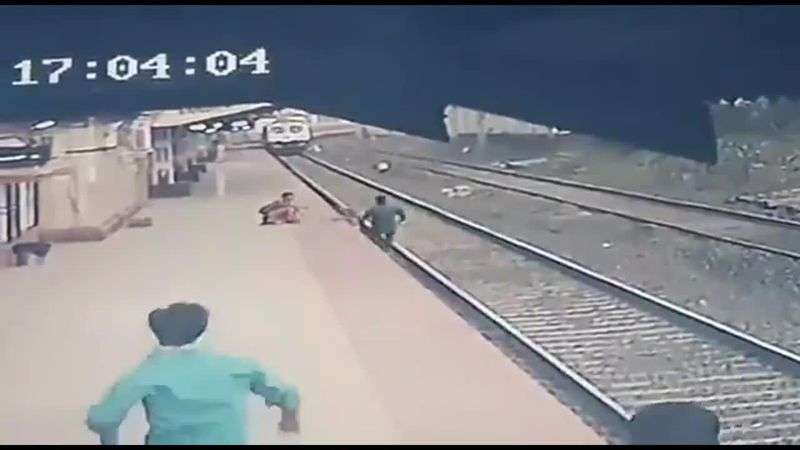 A railway worker raced into action after the child slipped and fell onto the tracks with a...
