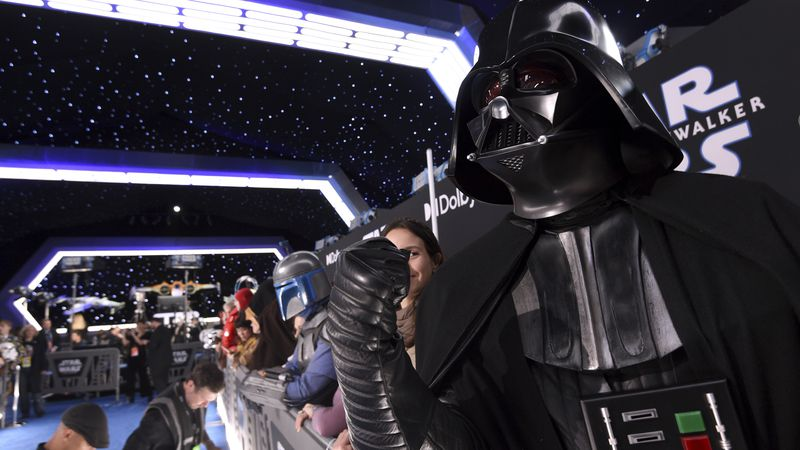 """Roberto Gomez, of Puerto Rico, dressed as Darth Vader, attends the world premiere of """"Star..."""